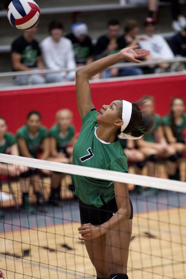 Southlake Carroll sophomore middle blocker Asjia O'Neal goes up for a hit against Allen during their playoff volleyball game Friday, November 6, 2015 at Flower Mound Marcus High School in Flower Mound, Texas. (Jeffrey McWhorter/Special Contributor)