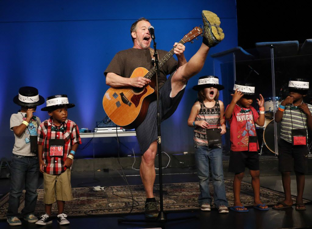 Singer and songwriter Eddie Coker of Colorado has volunteered at Camp Bravo for decades. He leads the children in a performance at the end of the camp's four-day run.