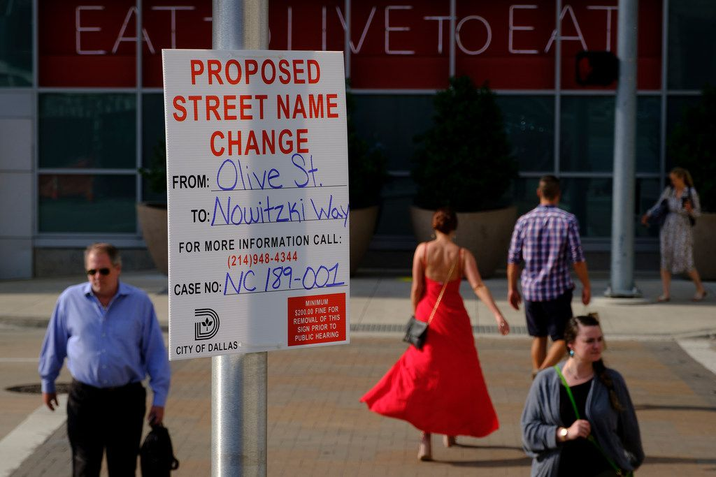 A sign at Olive Street and Victory Park Lane gives notice of a proposed renaming of Olive Street in honor of Dirk Nowitzki on Monday, May 20, 2019, in Dallas. (Smiley N. Pool/The Dallas Morning News)