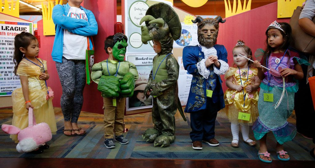 Krystal Bui, 3, Xavier Castillo, 3, Lucas White, 4, Brady Mahaffey, 4, Macie Mahaffey, 4, and Adalynn Trejo, 4, line up to be judge during the costume contest sponsored by the Friends of the Library at Smith Public Library in Wylie, Texas on October 23, 2018.  (Nathan Hunsinger/The Dallas Morning News)