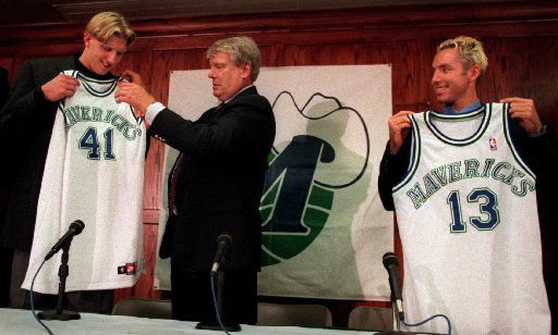 Mavericks coach Don Nelson (center) presents first-round draft pick Dirk Nowitzki (left) and newly acquired guard Steve Nash with jerseys at press conference in Dallas.