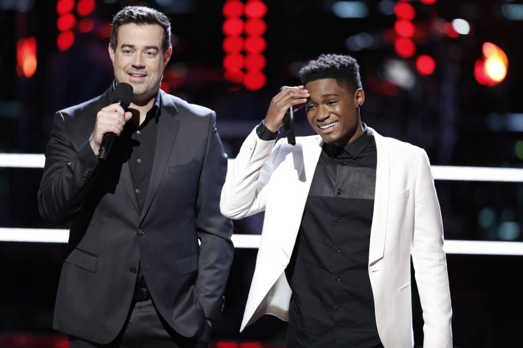 Host Carson Daly stands with Rowlett's Malik Heard after his performance during the battle round.