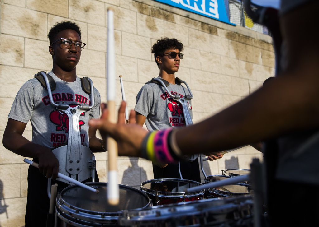 Cedar Hill snare drummers play on the sideline before a high school football game between Allen and Cedar Hill on Friday, August 30, 2019 at Eagle Stadium in Allen. (Ashley Landis/The Dallas Morning News)
