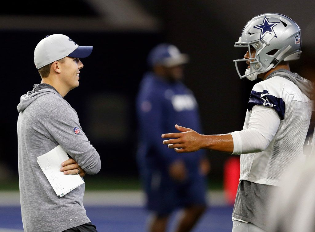 Dallas Cowboys offensive coordinator Kellen Moore and Dallas Cowboys quarterback Dak Prescott (4) talk between plays during practice at The Star in Frisco, Texas on Thursday, September 5, 2019. (Vernon Bryant/The Dallas Morning News)