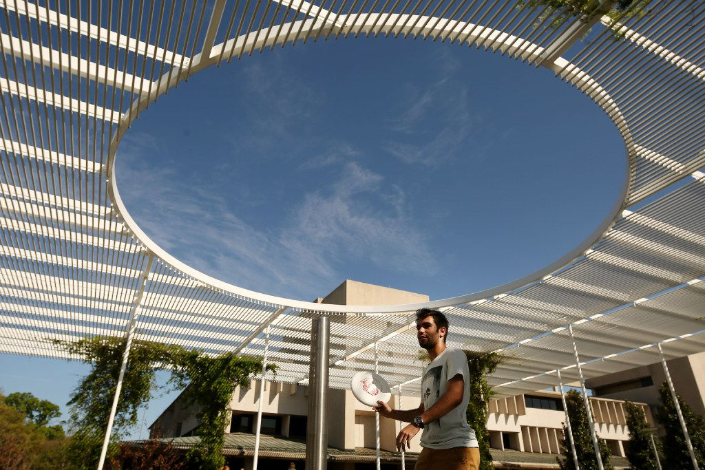 Daniel Barrios plays frisbee with other students near the student union on the campus of University of Texas at Dallas in Richardson, Texas Thursday March 23, 2017. Landscape architect Peter Walker designed part of the University of Texas at Dallas campus in Richardson, Texas. Walker completed the project in 2010. (Andy Jacobsohn/The Dallas Morning News)