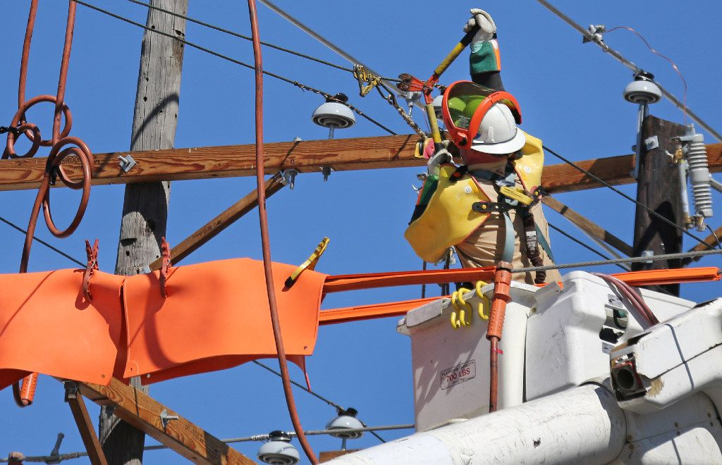 Oncor electricity crews worked along Canton Street near downtown Dallas in 2016.