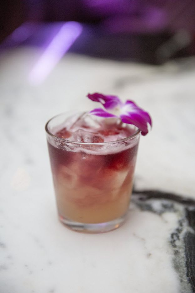 Uptown's new bar Citizen, offers a cocktail, New York Sour, including Herman Marshall, bourbon, Demerara syrup, red wine with an edible flower garnish, shown Thursday, November 12, 2015. (Allison Slomowitz/ Special Contributor)