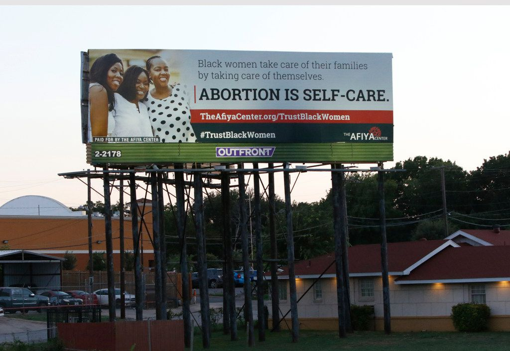 """A billboard put up by the Dallas-based Afiya Center proclaims """"abortion is self-care"""" and includes the hashtag #TrustBlackWome on Interstate 35E near the Illinois Avenue exit in Oak Cliff, the billboard follows another recent abortion message, the Black Pro Life Coalition's assertion that """"abortion is not healthcare."""""""