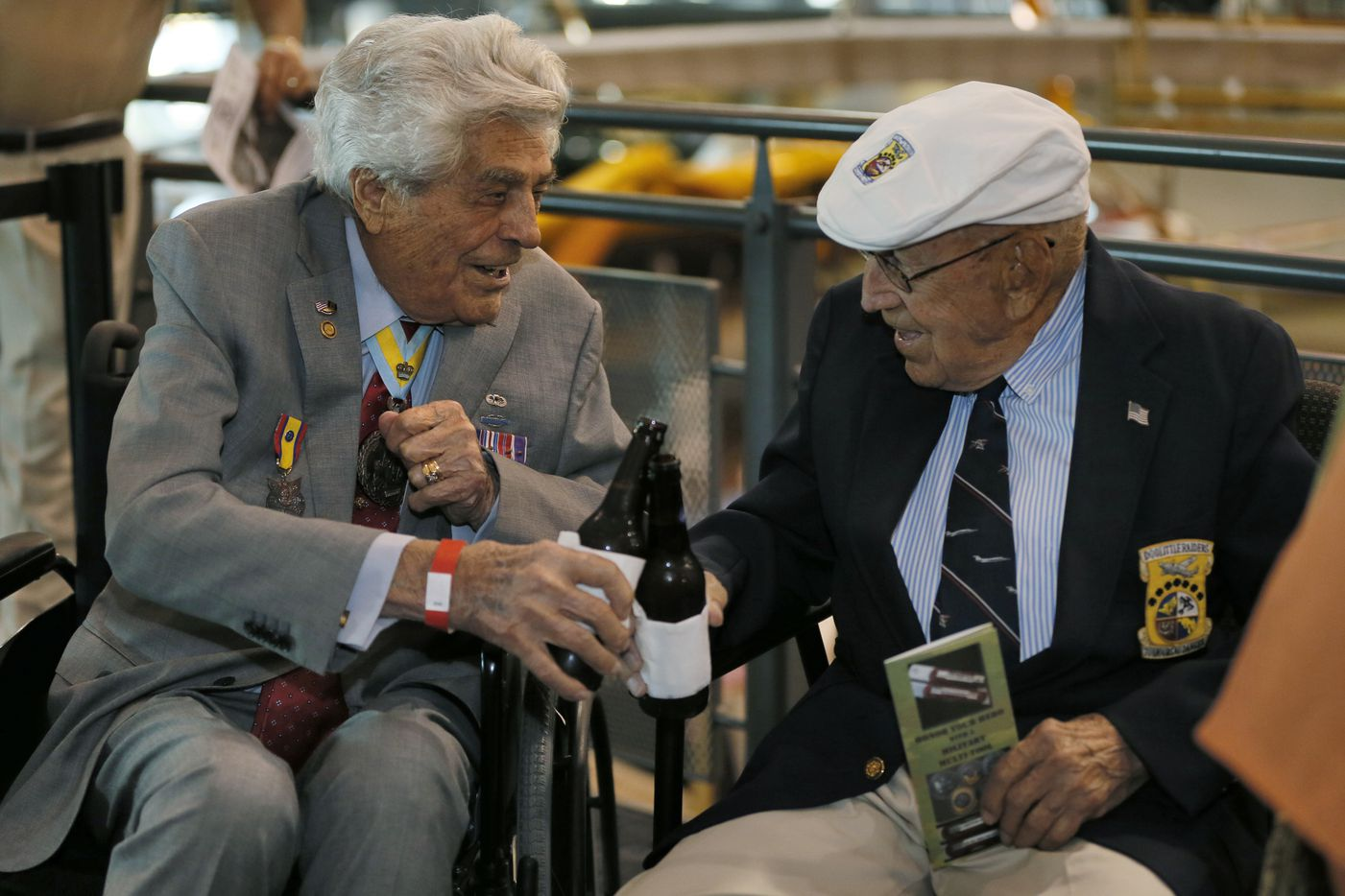 James Megellas, the most decorated officer in the 82nd Airborne, (left) and Richard Cole, co-pilot for Jimmy Doolittle on his famous 1942 Tokyo raid celebrates his 100th birthday, by toasting a beer during a reception for the survivors of the Doolittle raid at Frontiers of Flight Museum in Dallas in Dallas,  September 7, 2015. The two were on hand to see the premiere of 'Doolittle's Raiders: A Final Toast.'  (Nathan Hunsinger/The Dallas Morning News) ORG XMIT: moonday_0719met