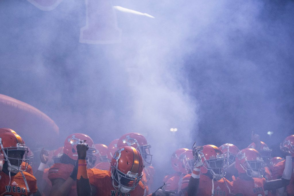 Lancaster Tigers high school football players wait in a cloud of smoke to be introduced before their game against Mansfield's Timberview Wolves in Lancaster, Texas on Friday, October 26, 2018. The Tigers were beating the Wolves 14 to 7 at the end of the first half. (Daniel Carde/The Dallas Morning News)