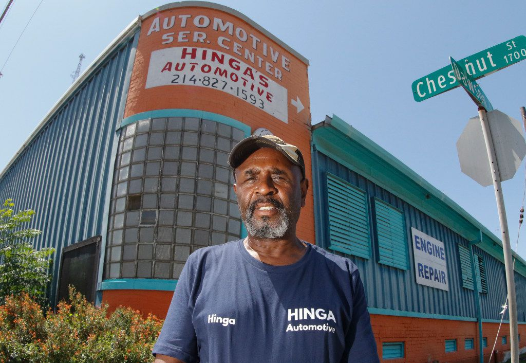 """Auto shop owner Hinga Mbogo, in front of his new location on Chestnut Street in Dallas, says, """"The city — they don't care about the little guy. They're going to do what they're going to do."""""""