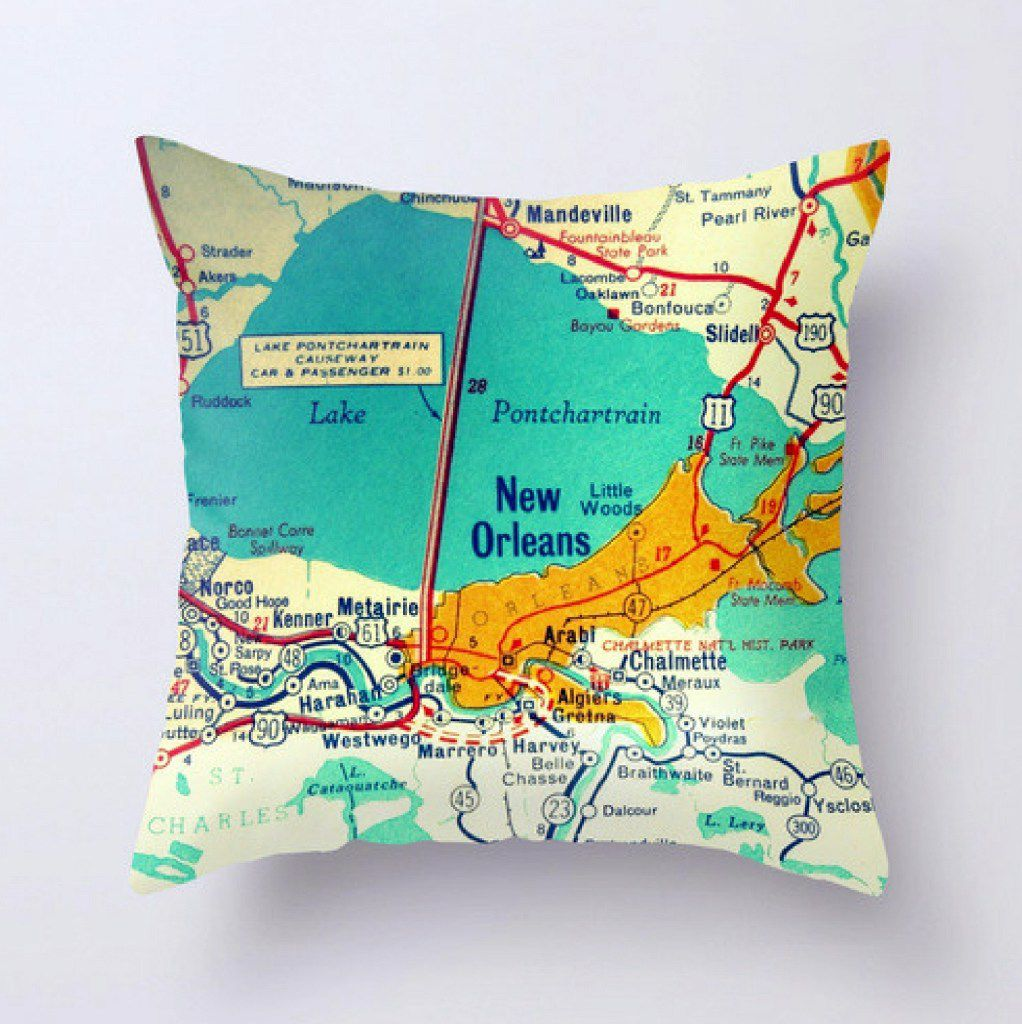 Bright tropical colors make Vintage Beach Maps' pillows stand out on a couch. Pick your place and they'll make what you want.