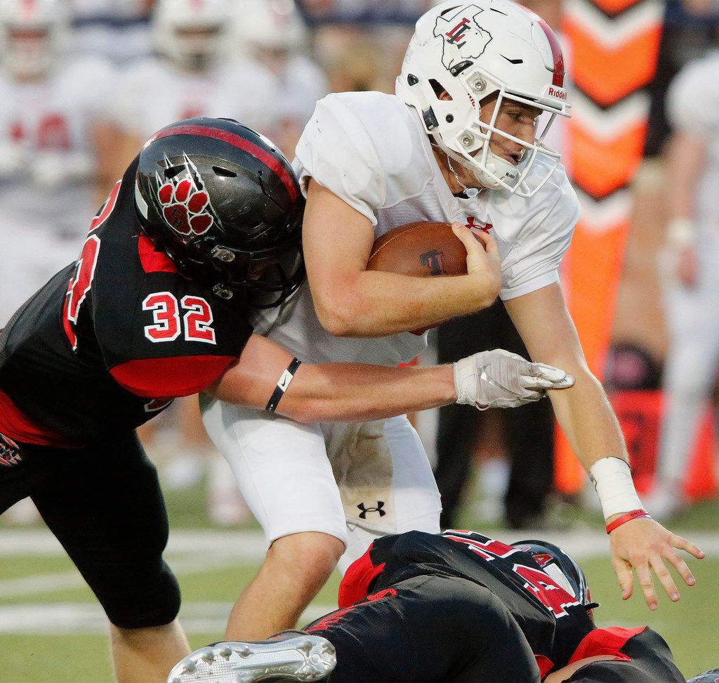 Lovejoy High School quarterback Ralph Rucker (10) is tackled by Colleyville Heritage High School linebacker Luke Lingard (32) during the first half as Colleyville Heritage High School hosted Lovejoy High School as part of the Tom Landry Classic at Eagle Stadium in Allen on Saturday, August 31, 2019. (Stewart F. House/Special Contributor)