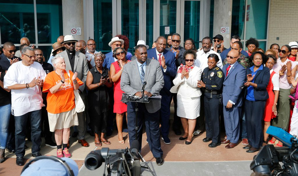 Dallas Mayor Pro Tem Casey Thomas is applauded as he speaks of his support for Dallas Police Chief U. Renee Hall during a rally of support for her by the African-American Pastors Coalition outside the Dallas Police Department Headquarters in Dallas on Friday, June 14, 2019. (Vernon Bryant/The Dallas Morning News)