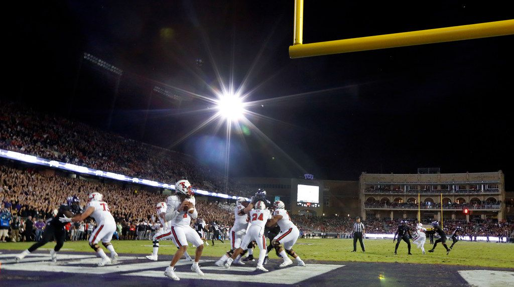 Lights were brought in on the visiting side of Amon G. Carter Stadium since the light towers were without power during the TCU Horned Frogs-Texas Tech Red Raiders football game in Fort Worth, Thursday, October 11, 2018. Texas Tech quarterback Jett Duffey (7) dropped back to pass in the end zone. (Tom Fox/The Dallas Morning News)