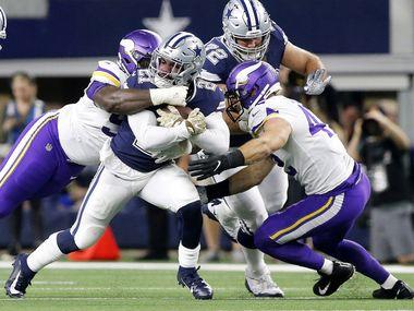 Dallas Cowboys running back Ezekiel Elliott (21) is tackled by the Minnesota Vikings defense during the first quarter on Sunday, Nov. 10, 2019 at AT&T Stadium in Arlington, Texas. (Tom Fox/The Dallas Morning News/TNS)