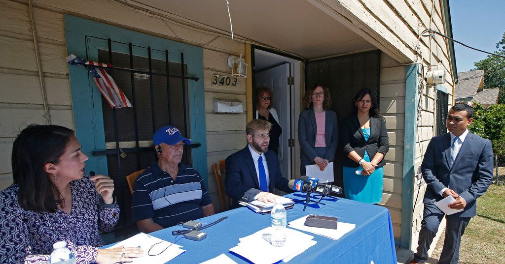 From left, interpreter Natali Franco, Julian Campos, Wayne Krause Yang, Mindy Henderson, Ann Maldonado Heaps, Stephanie Champion and Franklin Ortega during a news conference at the home of Julian Campos in Dallas on May 30, 2018. Legal Aid of Northwest Texas and Texas Legal Service center filed a federal lawsuit  on behalf of Campos, alleging consumer protection violations.