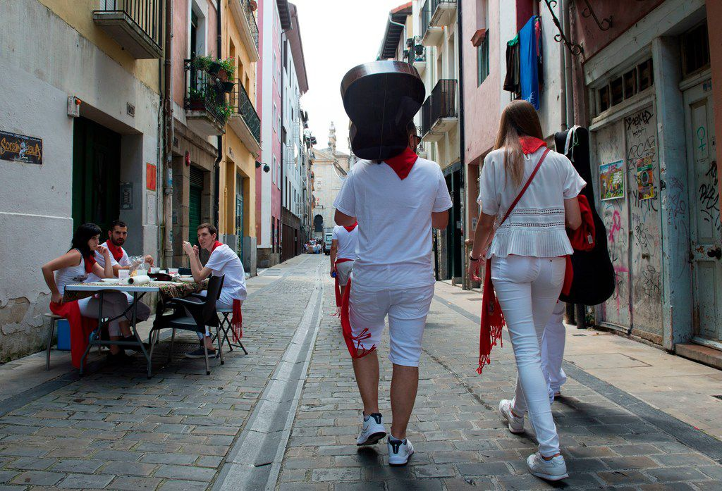 Revellers walk on the street on the first day of the San Fermin bull run festival in Pamplona.