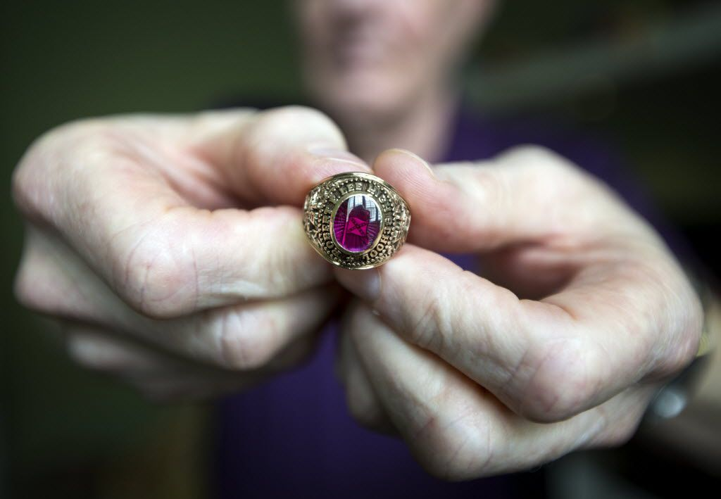 Terry, who requested that his last name not be published, holds his 1964 Midland Lee High School class ring, which has a small Confederate flag inside the stone.