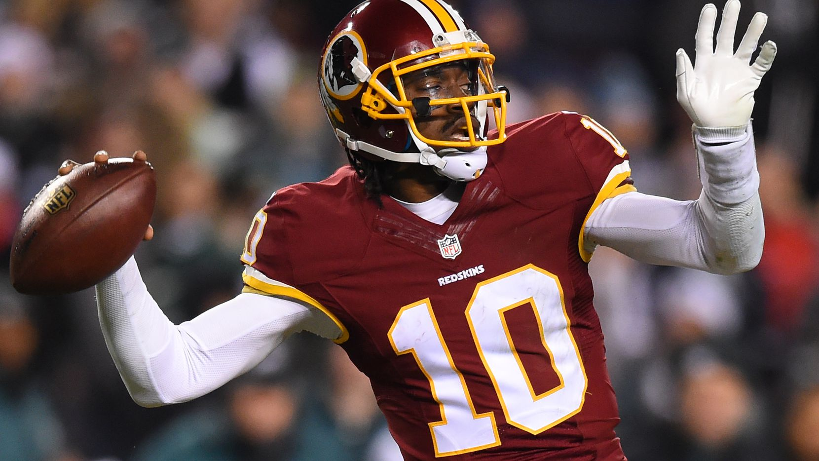 LANDOVER, MD - DECEMBER 20: Quarterback Robert Griffin III #10 of the Washington Redskins throws a pass in the second half against the Philadelphia Eagles at FedExField on December 20, 2014 in Landover, Maryland. The Washington Redskins won, 27-24. (Photo by Patrick Smith/Getty Images)