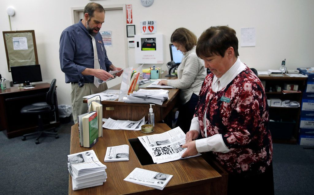 "Librarian Thelma Tracy, right, folds editions of the ""Weare in the World"" with her co-workers at the public library in Weare, N.H., Monday, Jan. 22, 2018. In the small New Hampshire town, they've found an unusual solution to the absence of a town newspaper, the local library is producing one. For the past year, library director Michael Sullivan and his staff have has produced and delivered their community newspaper. (AP Photo/Charles Krupa)"