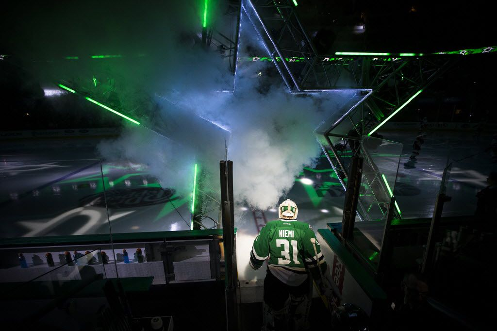 Dallas Stars goalie Antti Niemi (31) leads the team to the ice before facing the Calgary Flames in an NHL hockey game at the American Airlines Center on Monday, Jan. 25, 2016, in Dallas. (Smiley N. Pool/The Dallas Morning News)