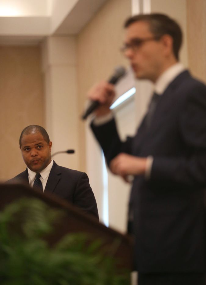 Candidate Eric Johnson (left) listens as candidate Scott Griggs speaks during a Dallas mayoral debate at the Belo Mansion in Dallas on Monday, May 13, 2019. Dallas Morning News political reporter Gromer Jeffers, Jr. moderated the event, which was sponsored by the League of Women Voters of Dallas, the Dallas Friday Group and the Public Forum Committee of the Dallas Bar Association. (Rose Baca/The Dallas Morning News)