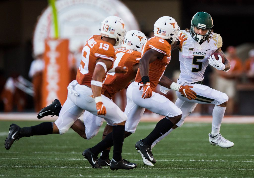 Baylor Bears wide receiver Jalen Hurd (5) is tackled by Texas Longhorns defenders during the third quarter of a college football game between Baylor and the University of Texas on Saturday, October 13, 2018 at Darrell K Royal Memorial Stadium in Austin, Texas.  (Ashley Landis/The Dallas Morning News)