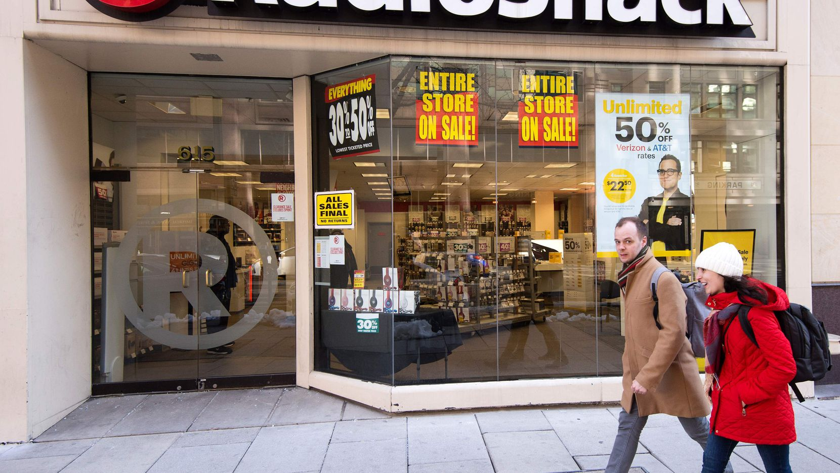 People walk past the Radio Shack in downtown Washington, DC, March 16, 2017, one of the 365 locations that Radio Shack intends to close by early April due to their second chapter 11 bankruptcy case in two years. / AFP PHOTO / PAUL J. RICHARDSPAUL J. RICHARDS/AFP/Getty Images