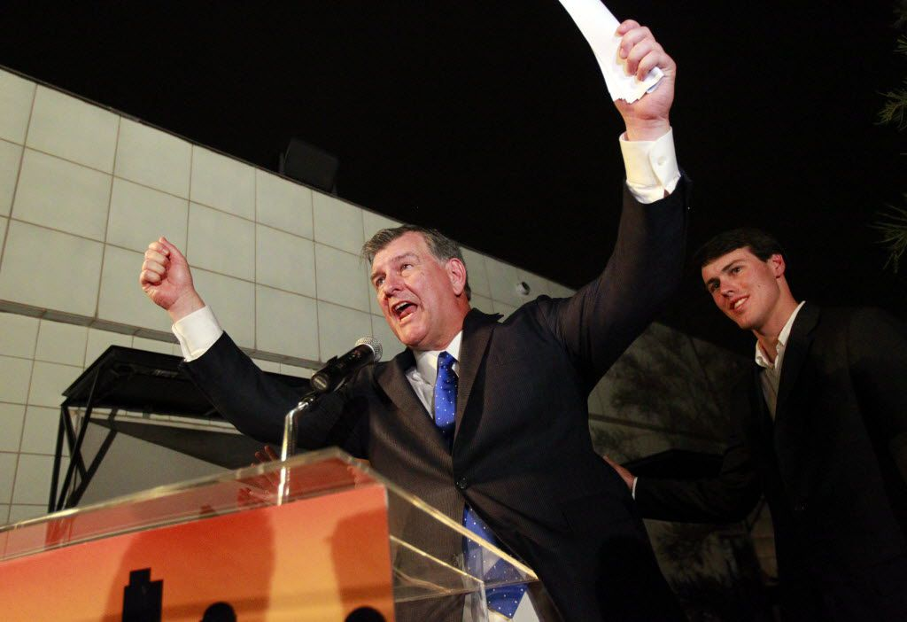 Mike Rawlings thanked his staff and supporters after receiving a call from former Dallas Police Chief David Kunkle conceding in the runoff election vote June 18, 2011.  His son, Gunnar, is at right.