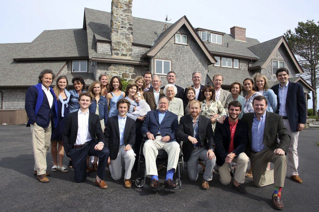 In this June 7, 2015 photo provided by the Office of George Bush, the Bush family posed for a photo at the family estate in Kennebunkport, Maine, to celebrate Barbara Bush's 90th birthday.
