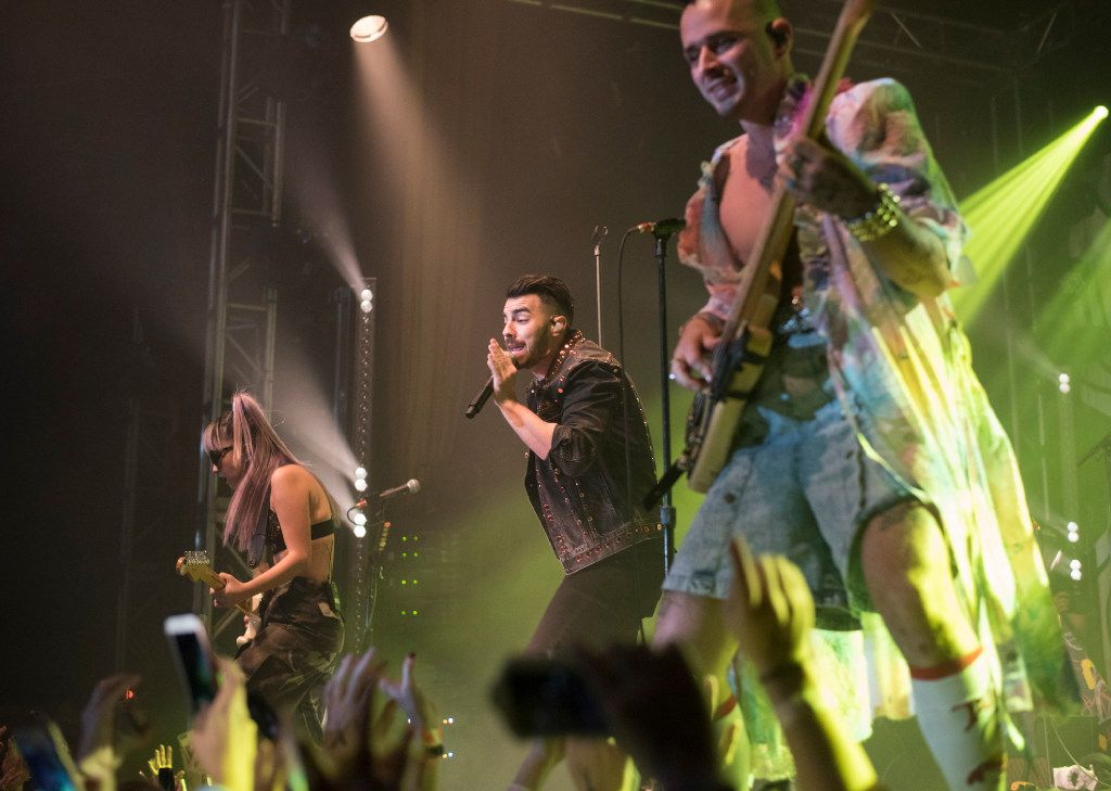JinJoo Lee, left, Joe Jonas, center, and Cole Whittle, of the band DNCE, perform at the Granada Theater on Saturday, Jan. 28, 2017.   (Rex C. Curry/Special Contributor)