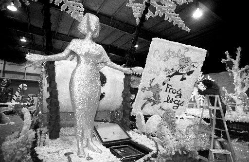 Dec. 2, 1993: Luis Baez of the Southwest Decorating Company of San Antonio (on ladder at right) puts the finishing touches on a float for the Adolphus/Children's Christmas Parade.