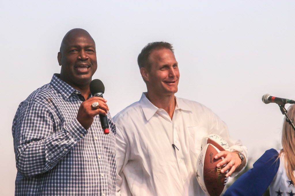 Former Dallas Cowboys players Charles Haley (left) and Chad Hennings helped raise money with autographed footballs.