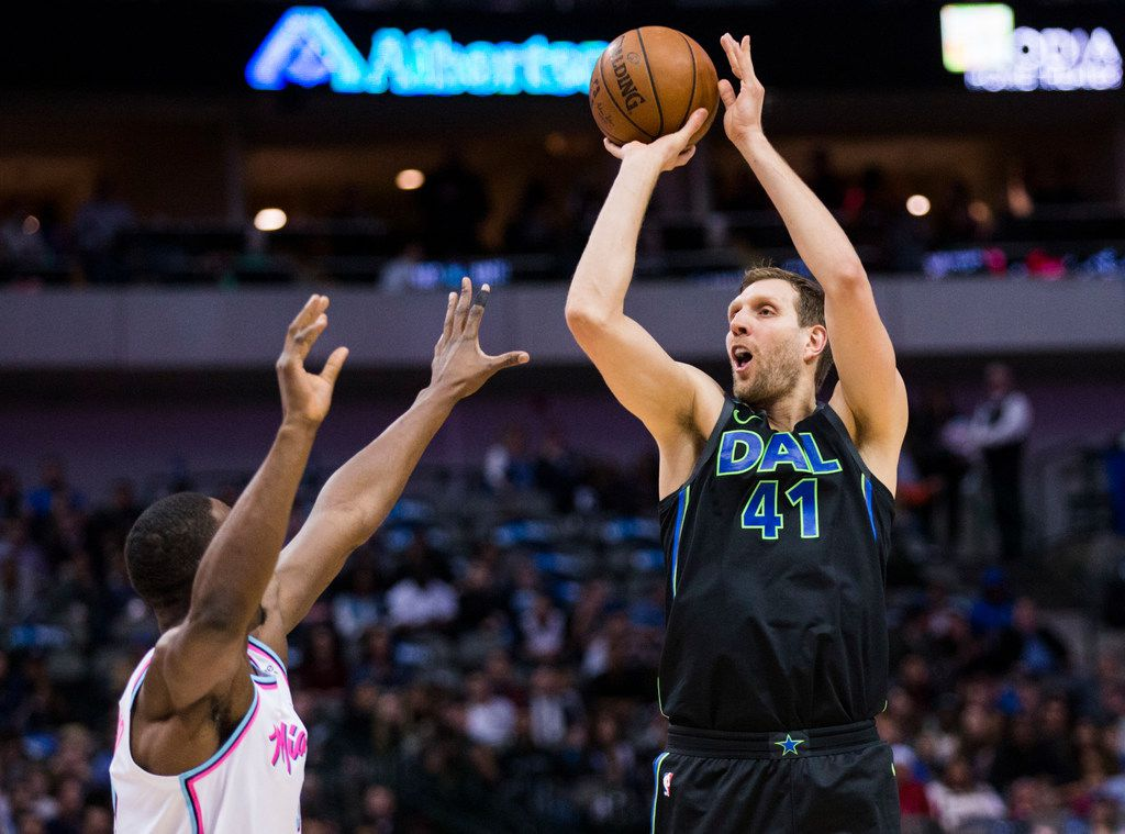 Dallas Mavericks forward Dirk Nowitzki (41) goes up for a shot over Miami Heat center Bam Adebayo (13) during the second quarter of an NBA game between the Dallas Mavericks and the Miami Heat on Monday, January 29, 2018 at American Airlines Center in Dallas. (Ashley Landis/The Dallas Morning News)
