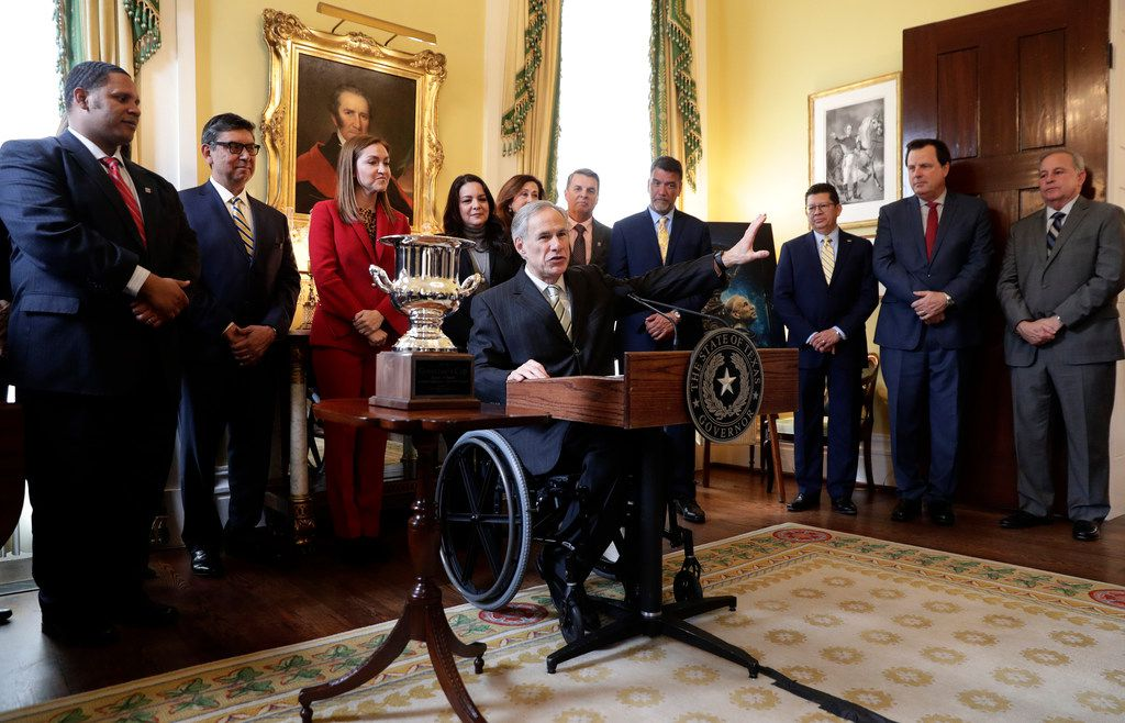Texas Gov. Greg Abbott, center at podium, lashed out at the Department of Public Safety during an economic development news conference at the Governor's Mansion in Austin on Monday. Abbott said DPS is 'despicable' at both issuing driver's licenses and helping interim Secretary of State David Whitley look for noncitizen voters. (AP Photo/Eric Gay)