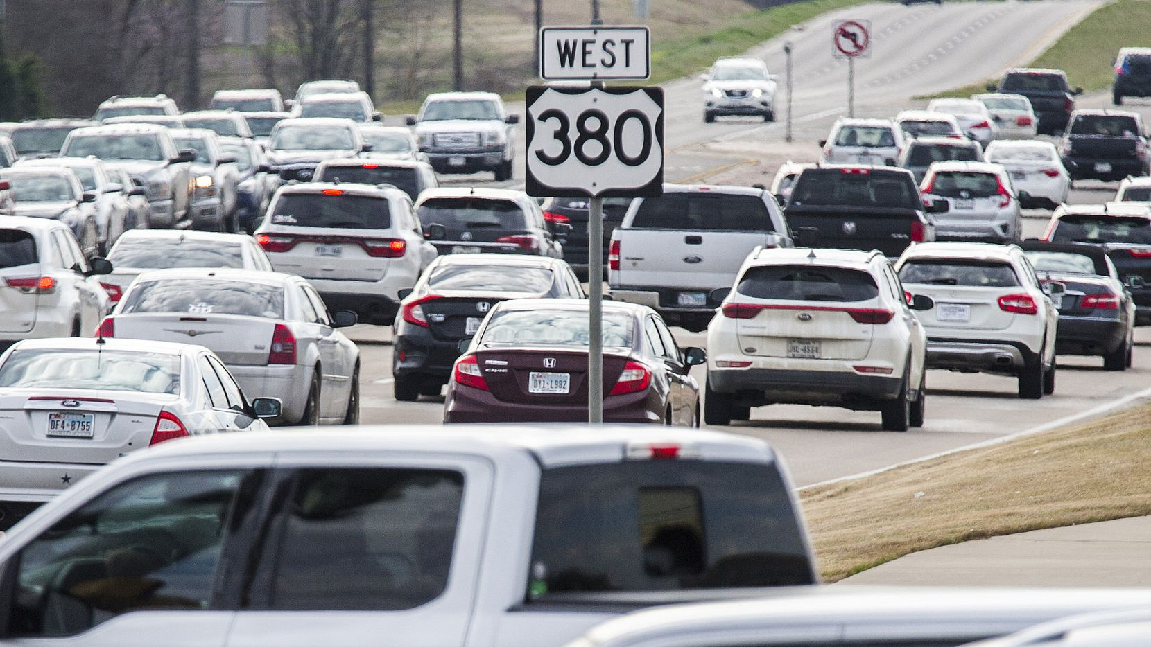 Traffic backs up at evening rush hour on U.S. Highway 380 near Lake Forest Drive in McKinney.  The Texas Department of Transportation is unveiling plans for a makeover of the over-crowded roadway, but ground likely won't be broken for at least five years.