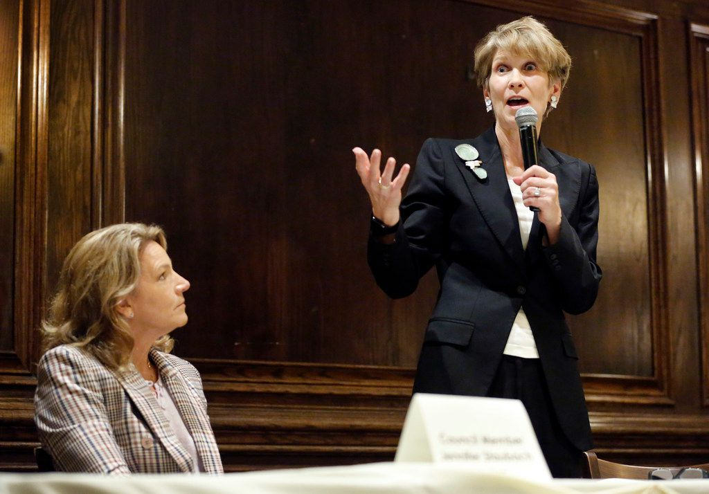 Dallas City Councilwoman Jennifer Staubach Gates (left) listens to former Dallas Mayor Laura Miller speak during a debate hosted by Dallas Builders Association at Maggiano's Little Italy at NorthPark Center in Dallas, Thursday, April 4, 2019.