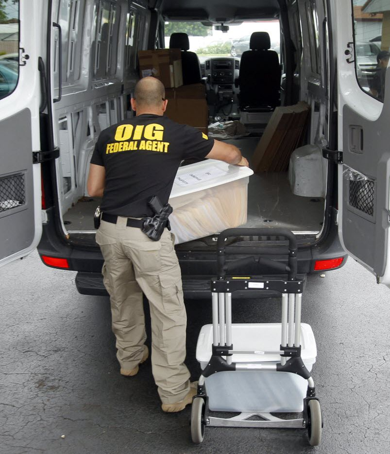 A federal agent load seized boxes from a Miami home health agency in 2012 as authorities charged more than 100 doctors, nurses and social workers in seven cities with Medicare fraud.