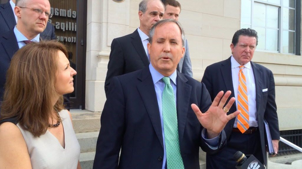 Surrounded by his wife and lawyers, Texas Attorney General Ken Paxton speaks on Friday, Sept. 2, 2016, outside the federal courthouse in Sherman, Texas after his lawyers debated federal prosecutors over whether Paxton tricked people to invest in obsolete computers before becoming the state's chief lawyer. (Avi Selk/The Dallas Morning News)