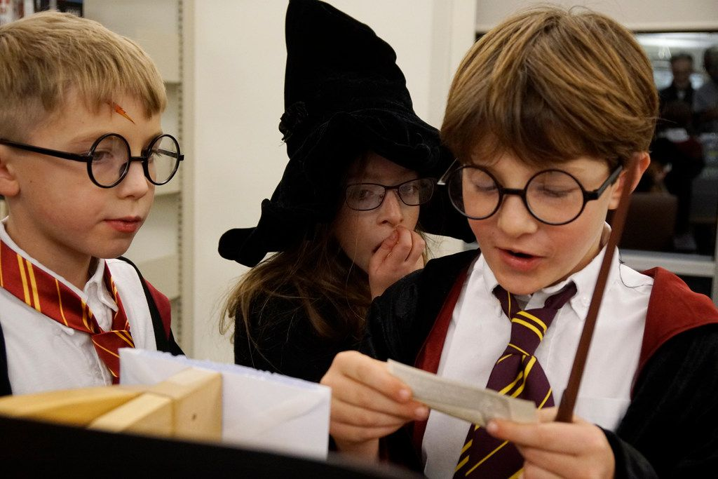 Jack Wilson (8), Esther Fripp (10), Gabe Masino (8), participate in the scavenger hunt at the Harry Potter Yule Ball at the Josey Ranch Lake Library in Carollton, Texas on Friday December 29, 2017.