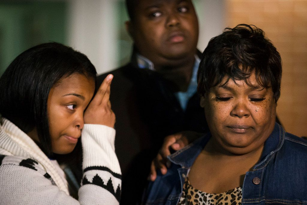 Jacqueline Craig (right) attends a press conference with her 15-year old daughter (left) and cousin Rod Smith outside the Fort Worth Police Department Bob Bolen Public Safety Complex on Thursday, Dec. 22, 2016, in Fort Worth.