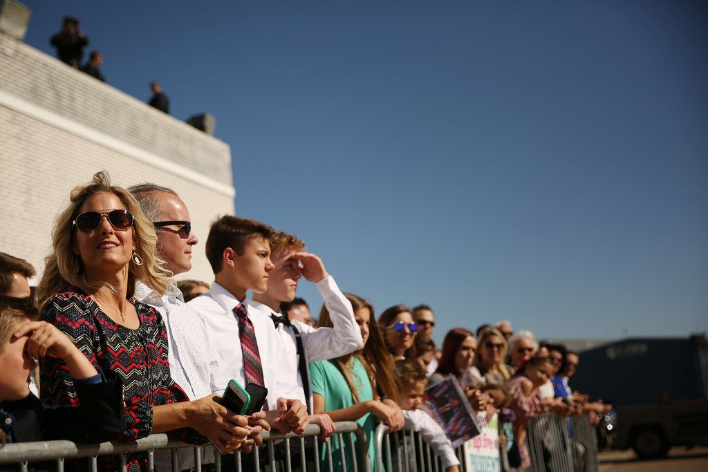 Supporters wait for President Donald Trump to arrive before Trump's visit to Dallas while at Signature Flight Support near Love Field in Dallas Wednesday October 25, 2017. President Trump participated in a hurricane recovery briefing, a Republican National Committee roundtable and gave remarks at a reception. (Andy Jacobsohn/The Dallas Morning News)