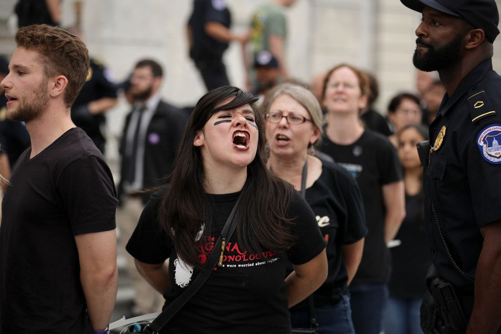 Protesters shout, sing and chant after being arrested by U.S. Capitol Police for demonstrating against the confirmation of Supreme Court nominee Judge Brett Kavanaugh on the center steps of the East Front of the U.S. Capitol Oct. 6, 2018 in Washington, D.C.