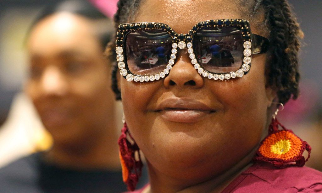 Katrina Whitfield tries on some stylish sunglasses during the Afrolicious Hair and Beauty Expo at the Dallas Westin Park Central in north Dallas on Sunday, August 5, 2018.