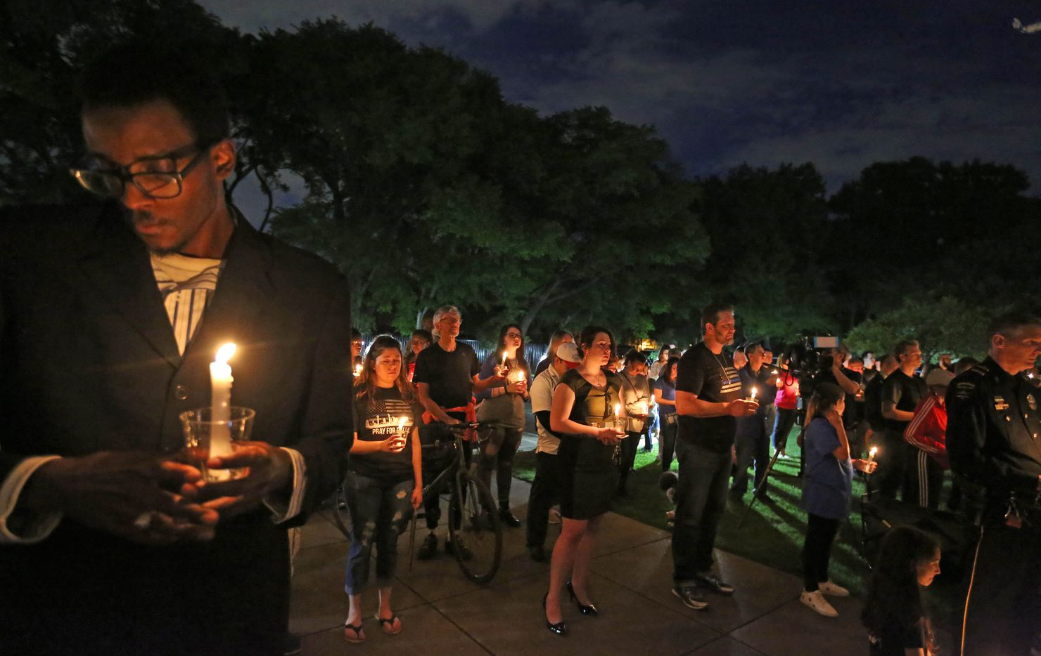 Area residents turn out to show their support at a candlelight vigil to support Dallas Police Officer Crystal Almeida, and to honor the memory of Officer Rogelio Santander, Jr., held at the Dallas Police Northeast Division substation on Thursday, April 26, 2018.