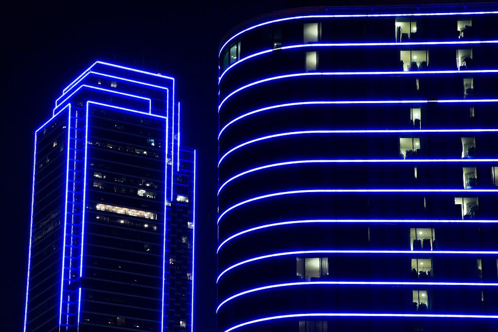 Bank of America and the Omni Dallas Hotel glow blue as the downtown Dallas skyline lights up in blue in recognition of National Police Week on May 15, 2017.