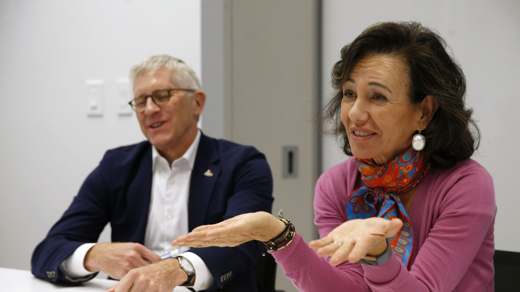 Ana Botin (right), executive chairman of Banco Santander, and Scott Powell, CEO of Santander Consumer USA, said they've improved the financial controls and standards at the subprime lender. Despite a high share of troubled loans, they're not worried about a downturn.