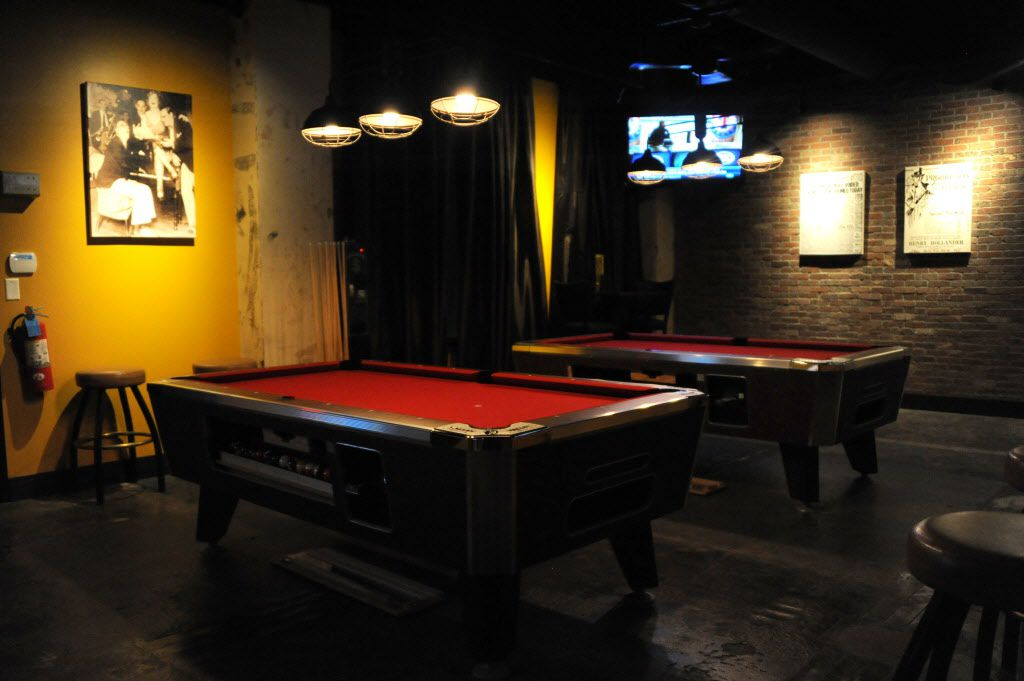 Go downstairs, through the bar and around the corner, and there's a small pool room with darts and Golden Tee.