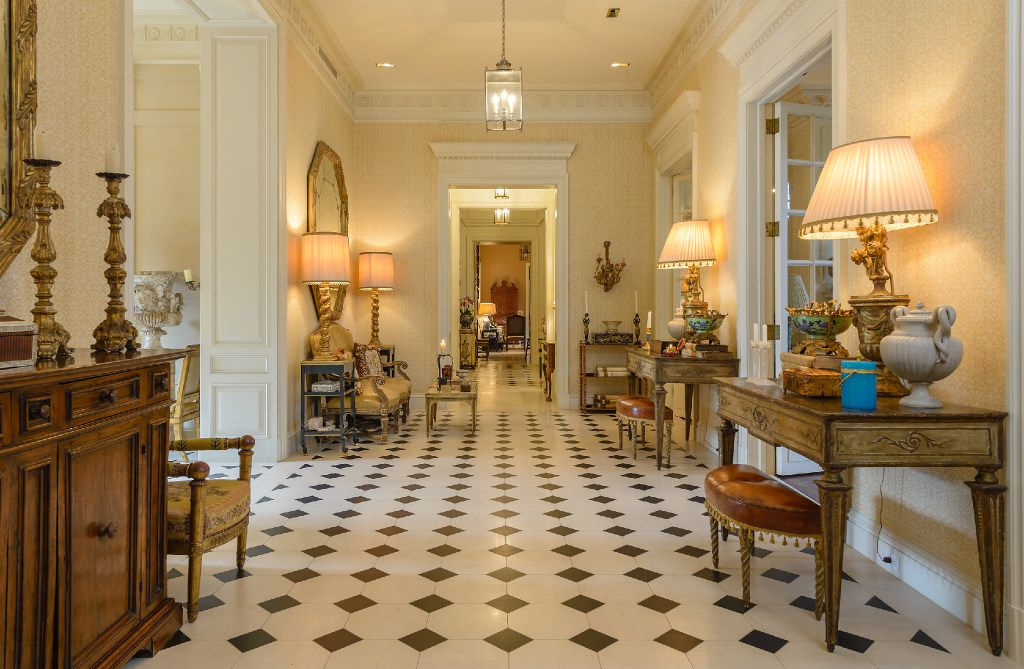 A black and white limestone floor in the cross hall of the Bobby Haas estate in Preston Hollow.